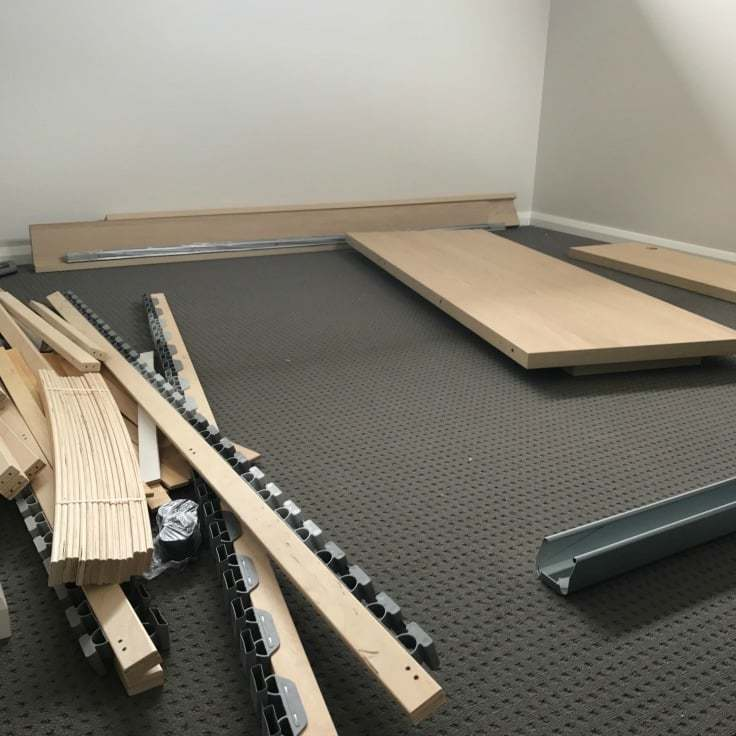 ikea flatpack furniture on grey bedroom floor