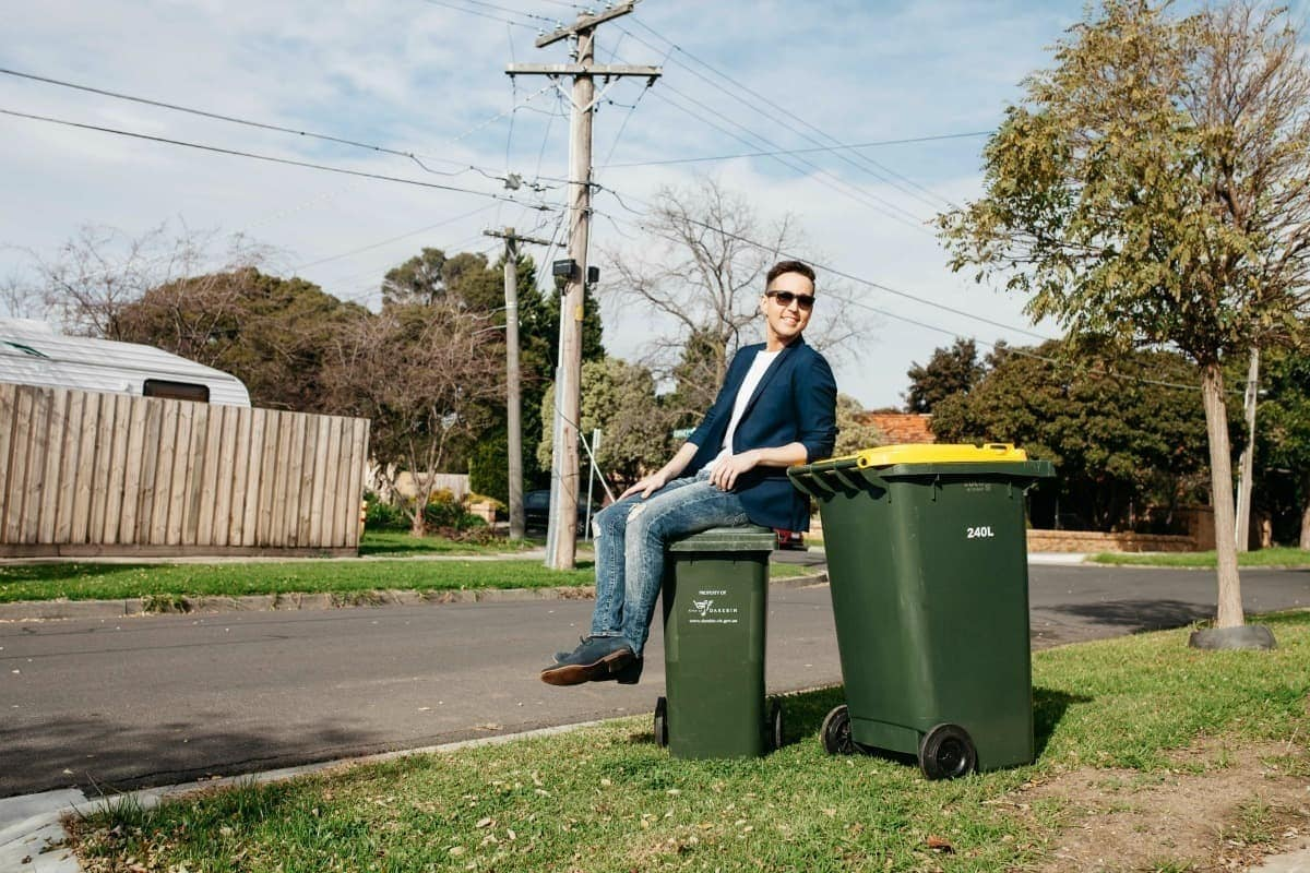 living in the suburbs sitting on top of garbage bin