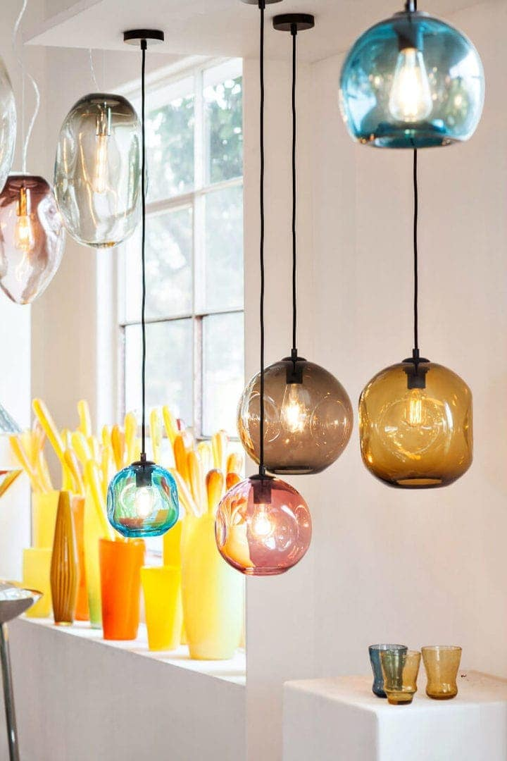 mark douglass coloured glass pendant lights hanging in showroom window