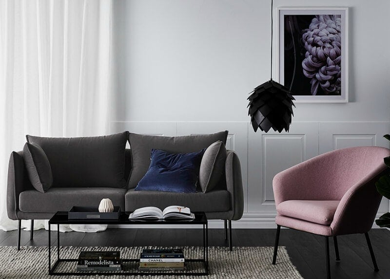 stockholm sofa from adairs in charcoal grey with pink armchair