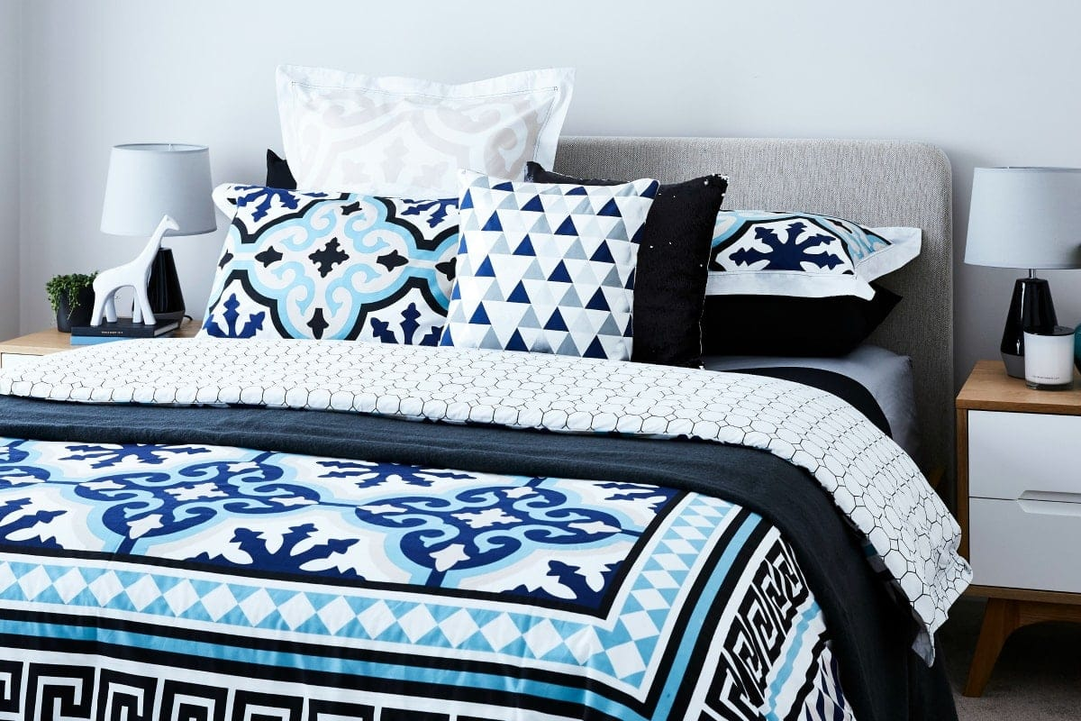 blue and white bed styling ideas featuring lorraine lea bedding by TLC interiors