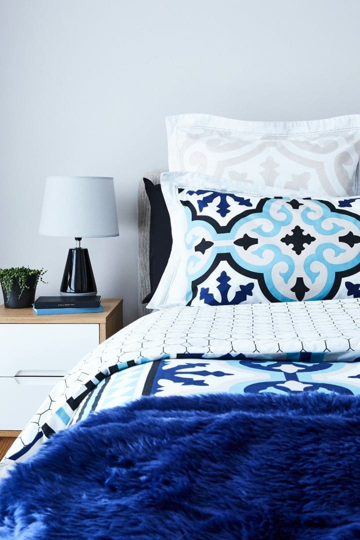 blue and white mosaic bed styling ideas from tlc interiors