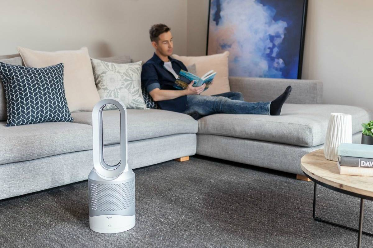 chris carroll with dyson air purifier in his home