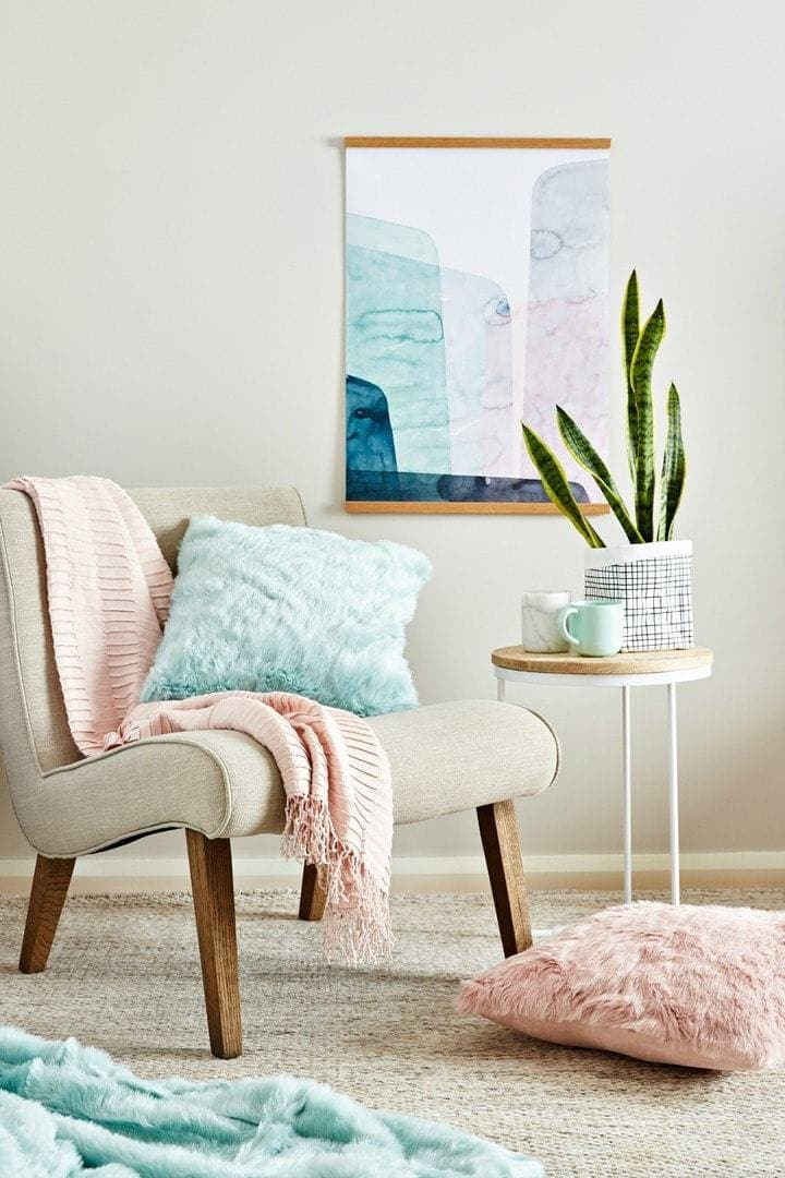 mint and blush living room styling with beige armchair and faux fur cushions by tlc interiors