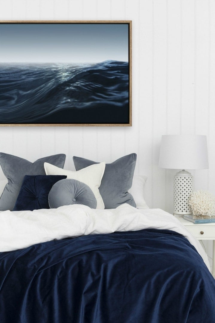 ocean art from urban road in white and navy blue bedroom