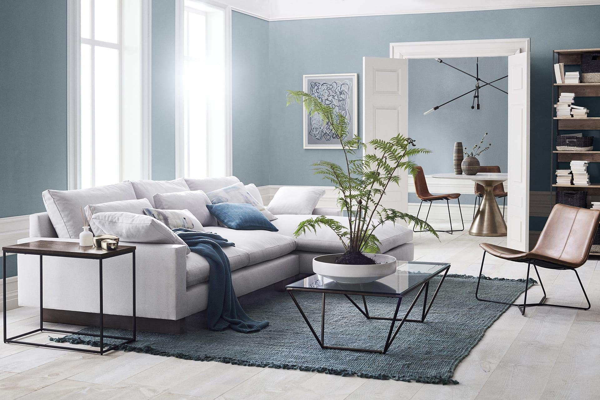West Elm Living room with light blue walls and white trims