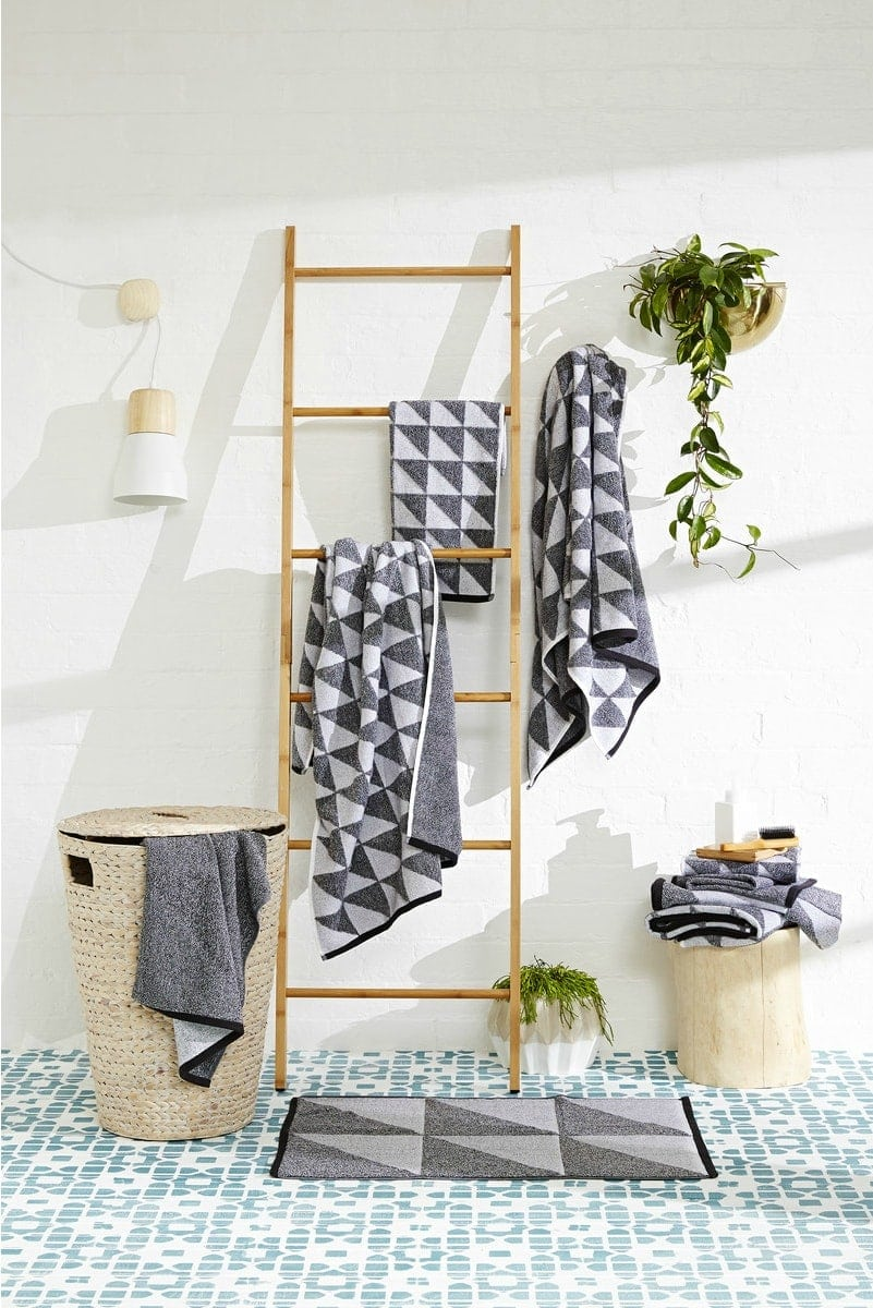 bamboo ladder from kmart in bathroom with black and grey geometric towels