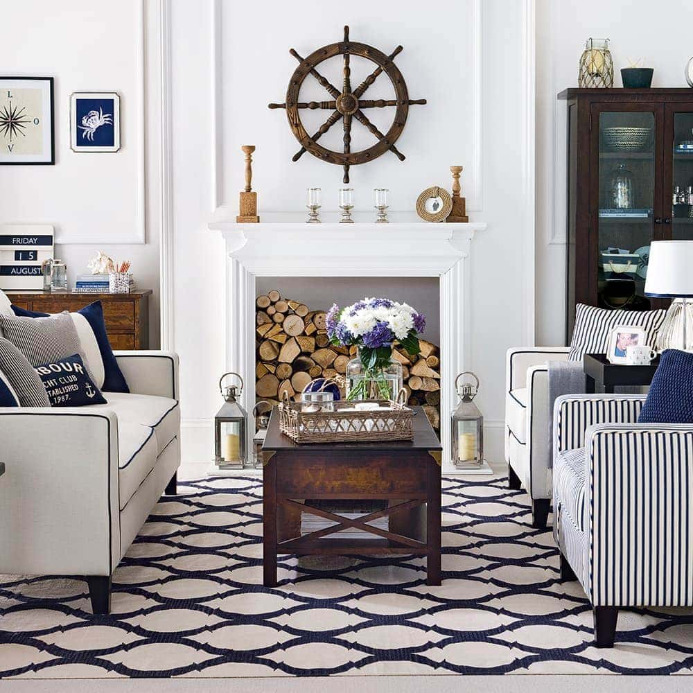 blue and brown hamptons style living room with nautical motifs