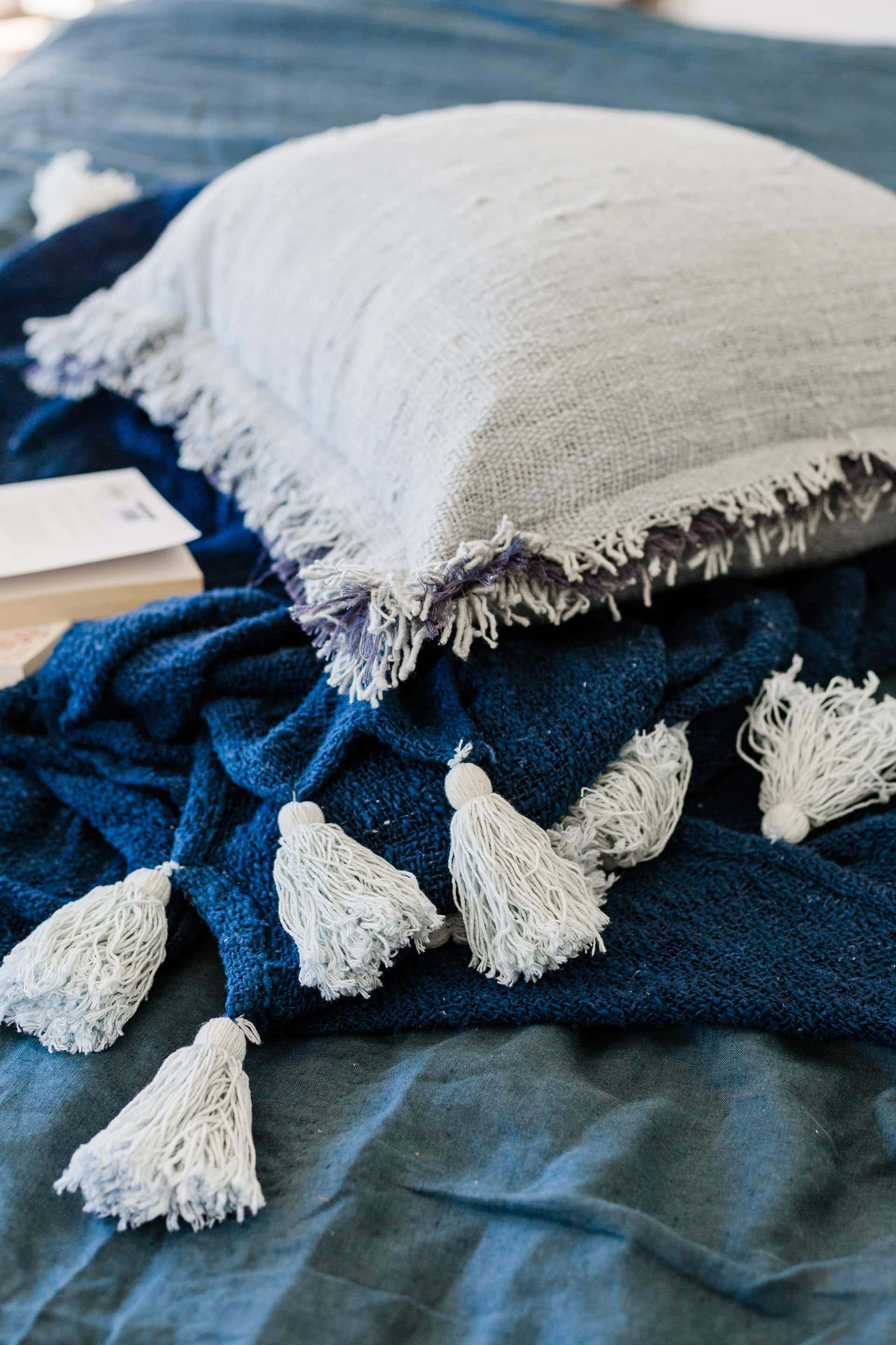 blue and green bed linen from southbound with white tassels