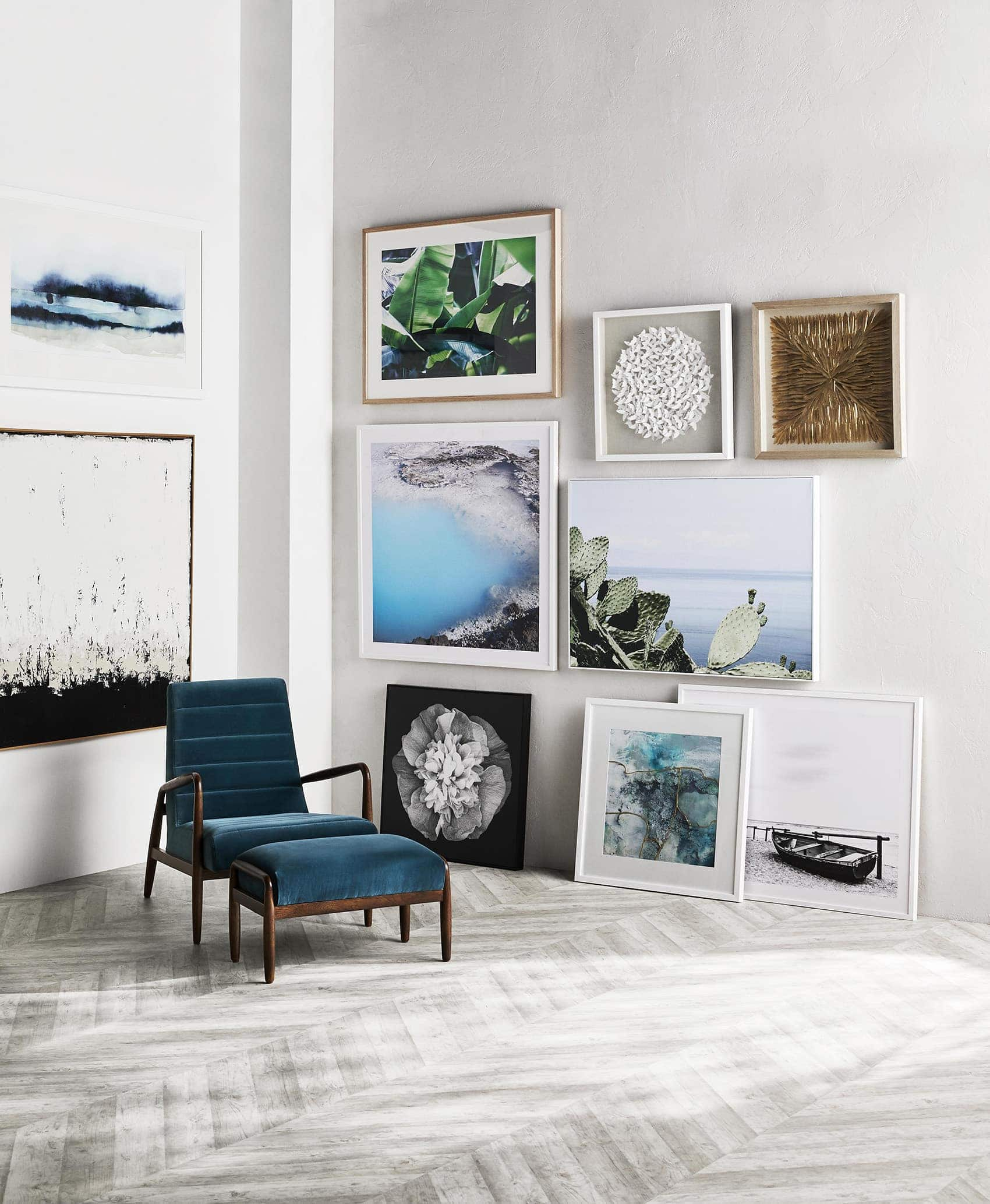 how to do a gallery wall white wall with herringbone floorboards and velvet blue chair
