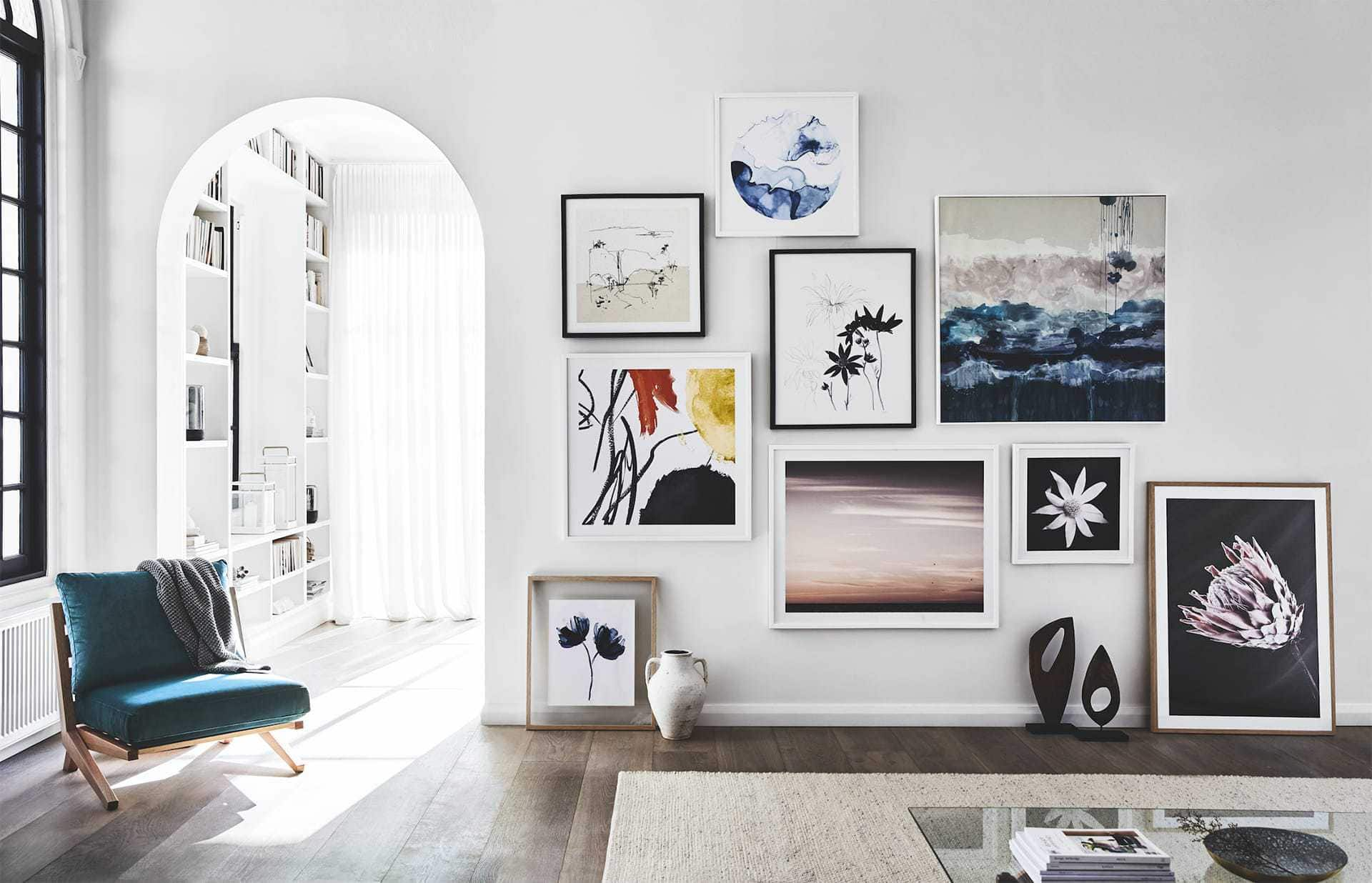 mixing art on a gallery wall in living room from sheridan