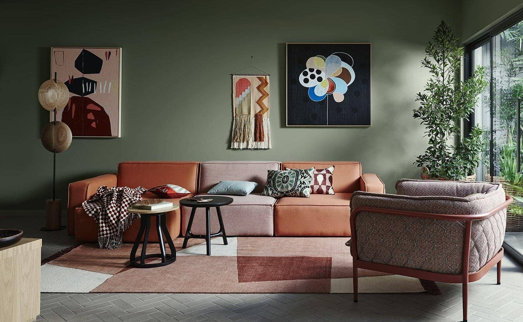 olive green feature wall with terracotta sofa from dulux 2018 paint forecast