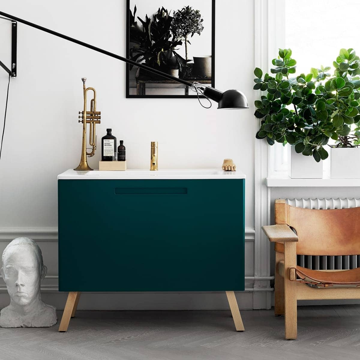 sideboard styling dark green sideabord with gold and white accessories