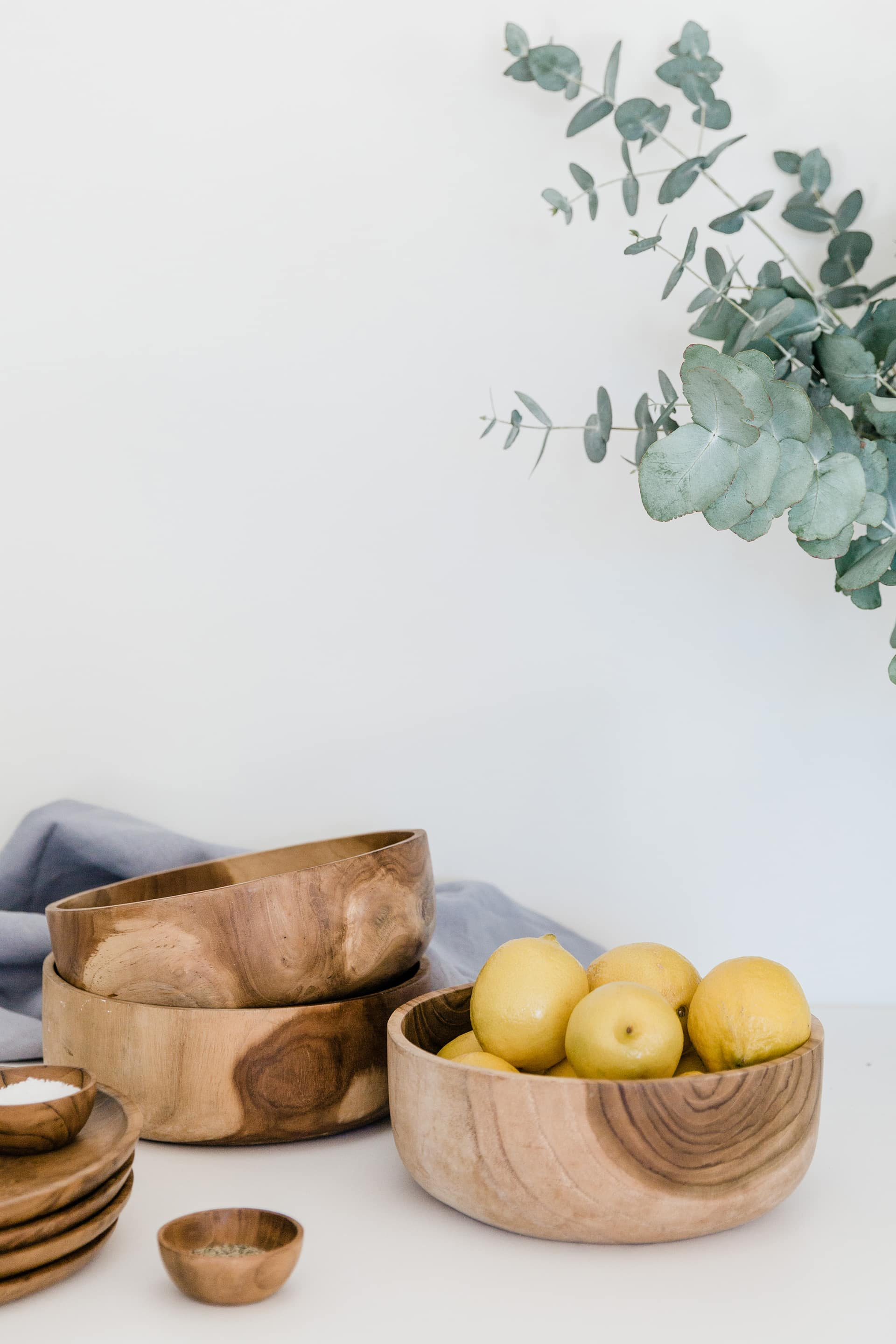 southbound round wooden bowls in kitchen with lemons