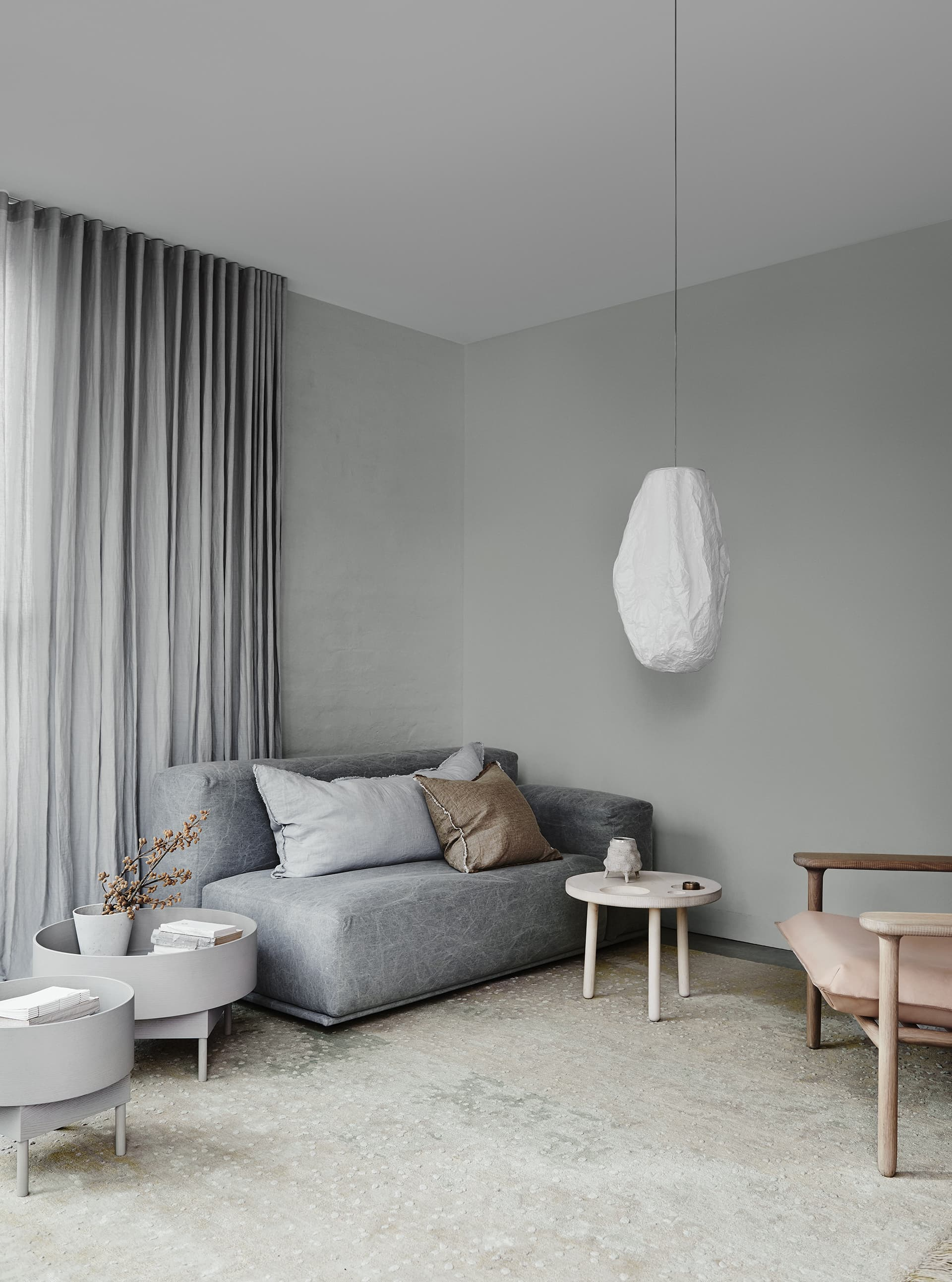 subdued living room from dulux with muted grey sofa and leather cushion
