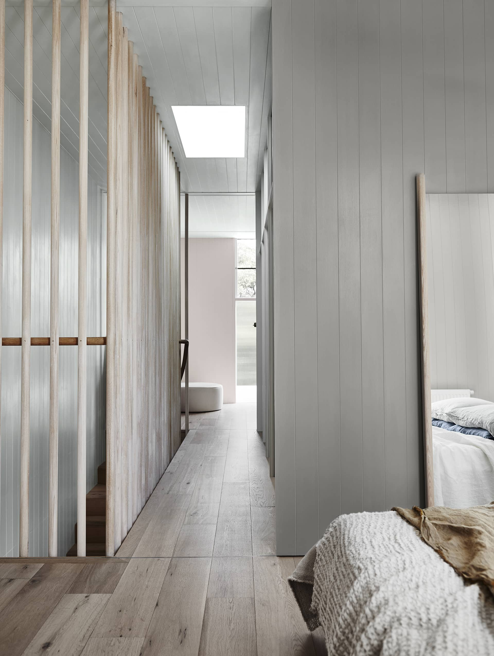 timber floorboards in bedroom with vertical timber wall panelling by dulux 2018