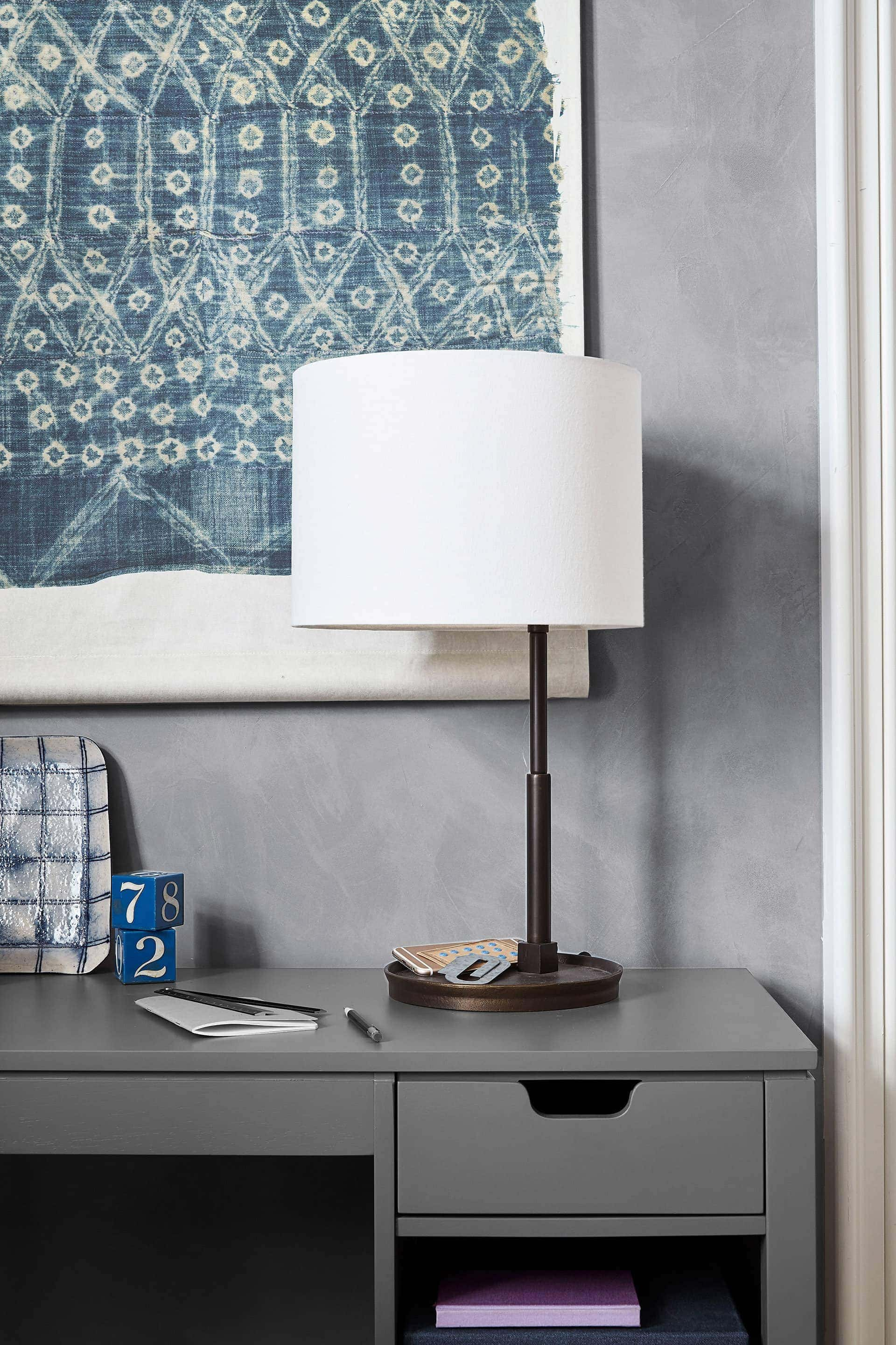 white linen shade table lamp from pottery barn on grey office desk
