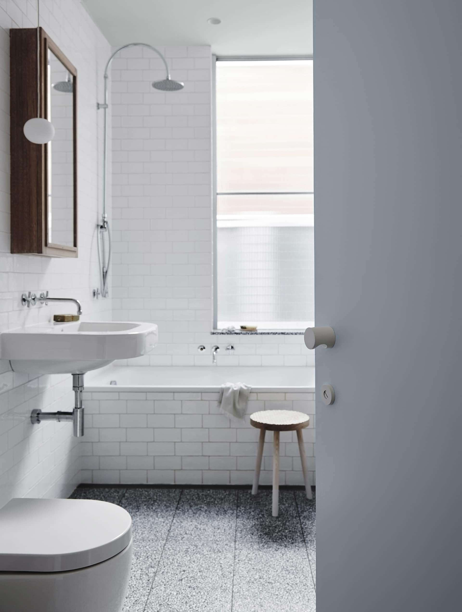 white subway tile bathroom with powder blue bathroom door from dulux