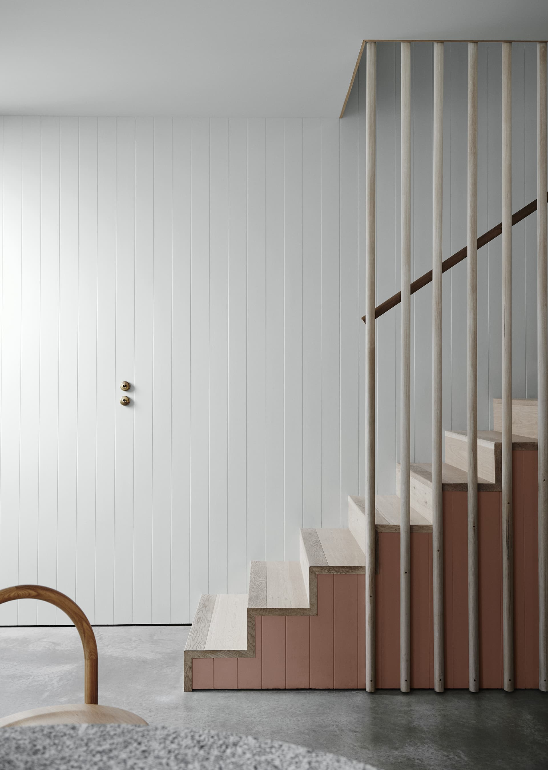 whitewashed timber staircase from dulux with white pannelled wall