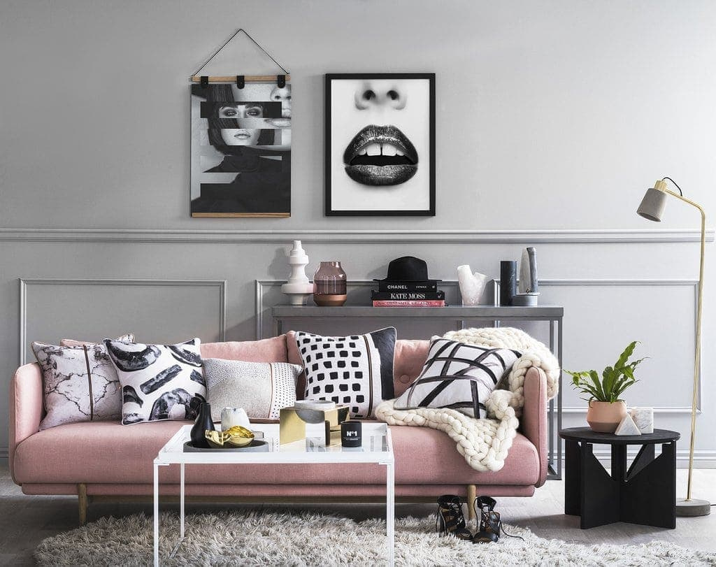 art club concept black and white cushions on pink sofa in living room