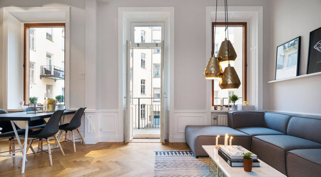 pendants lights in corner of living room chic parisian apartment with herringbone flooring