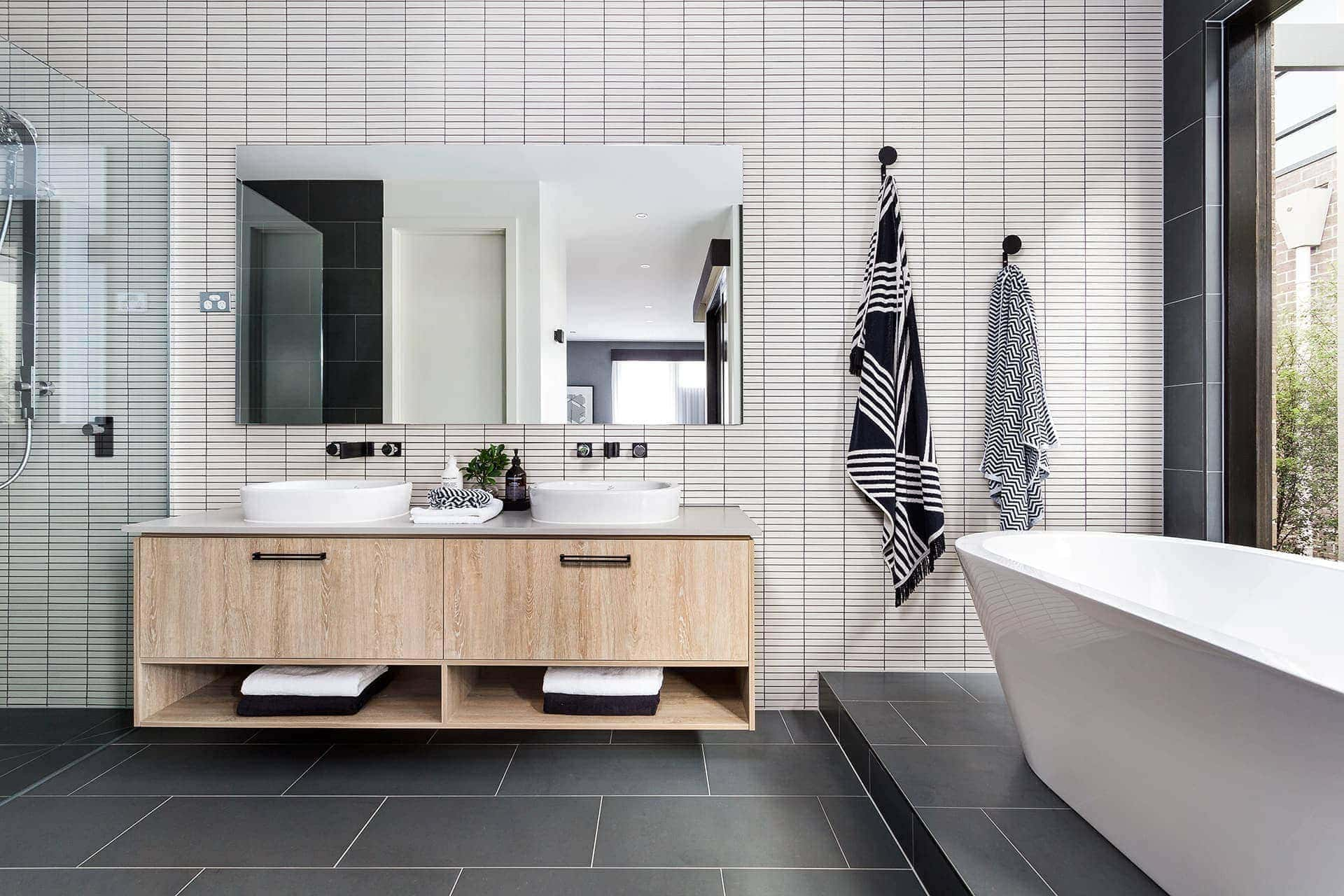 bathroom with white rectangular bathroom tiles grey grout and charcoal floor tiles