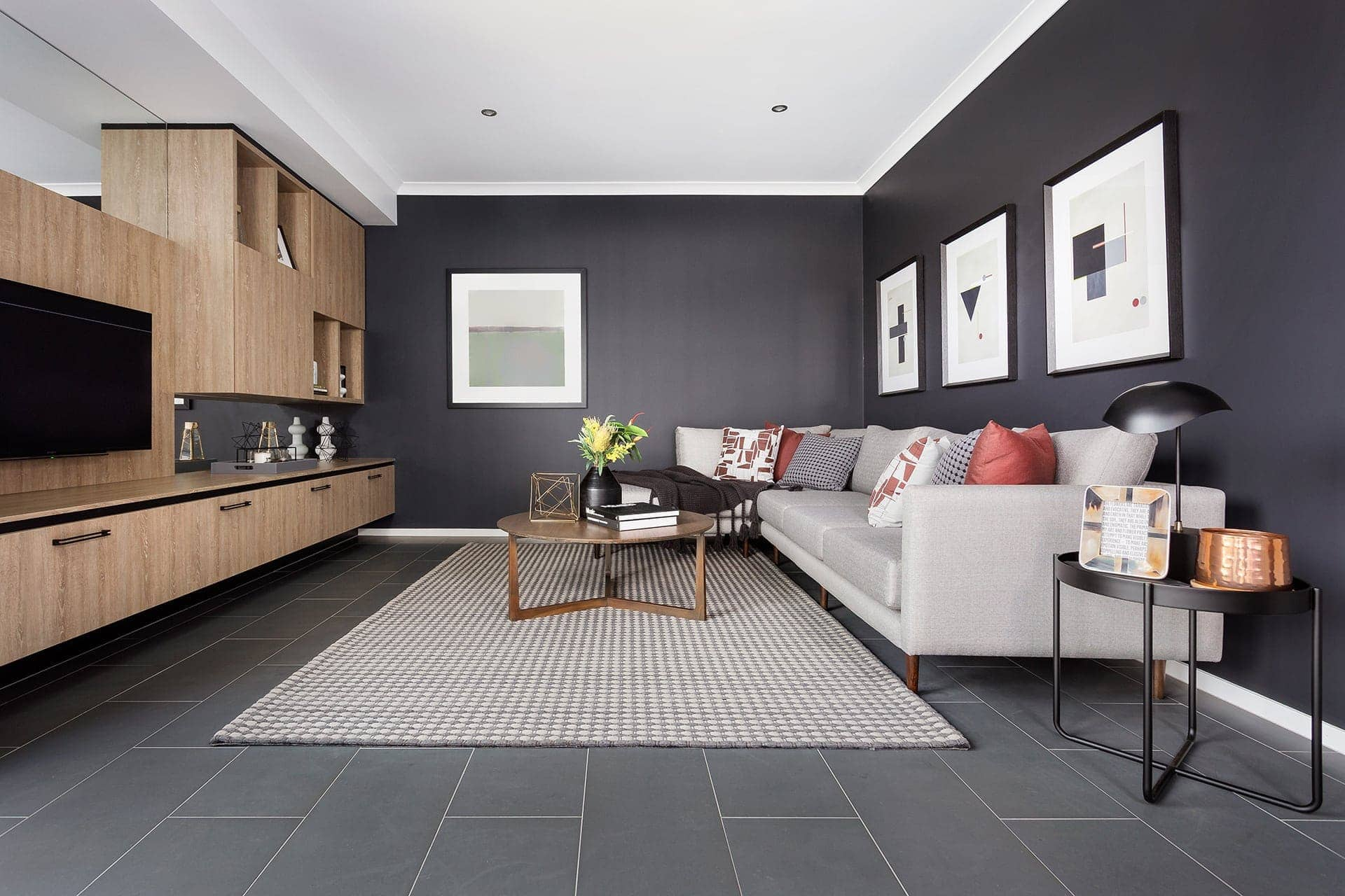 dark grey living room wall with floor tiles in living room from metricon