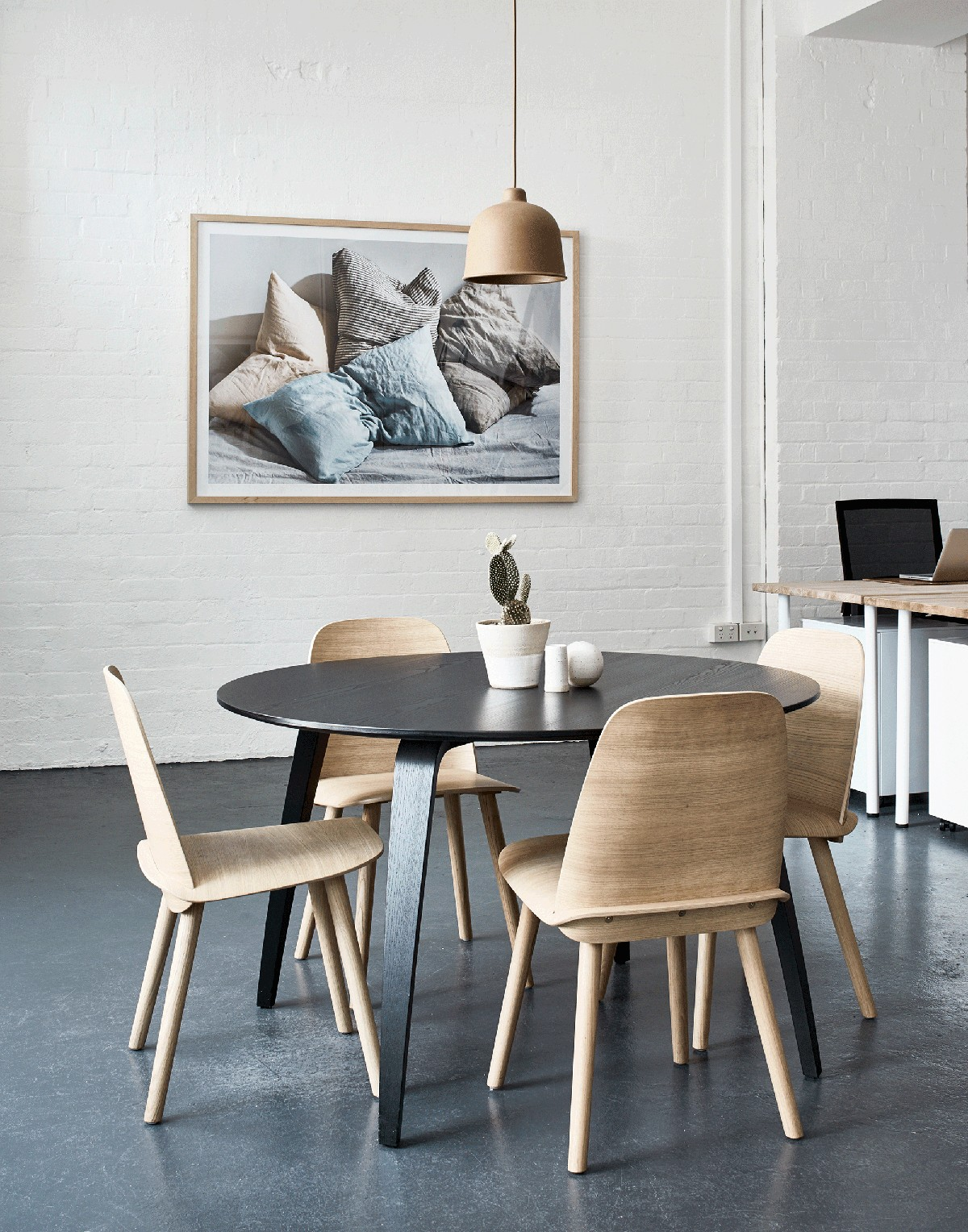 minimal dining room with round dining table and concrete floor