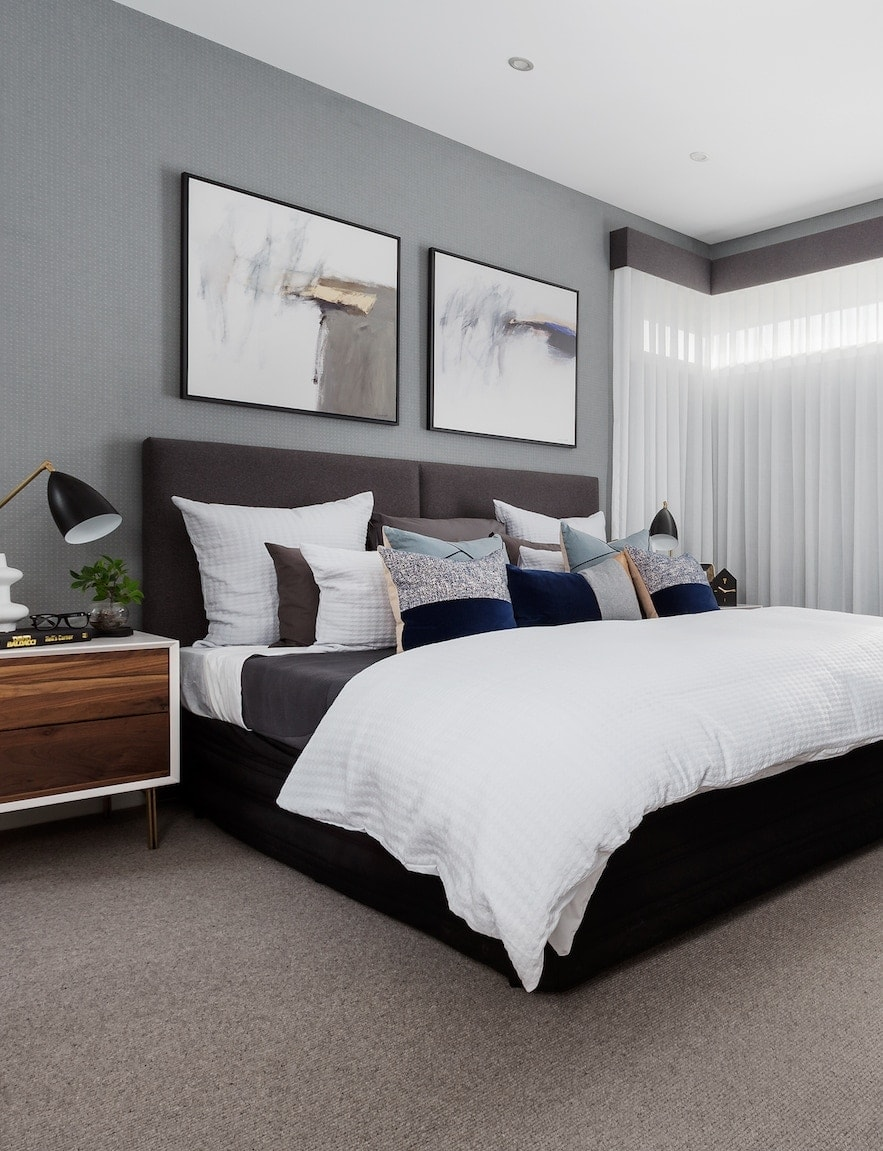 modern master bedroom with grey wallpaper design and white bedding from metricon