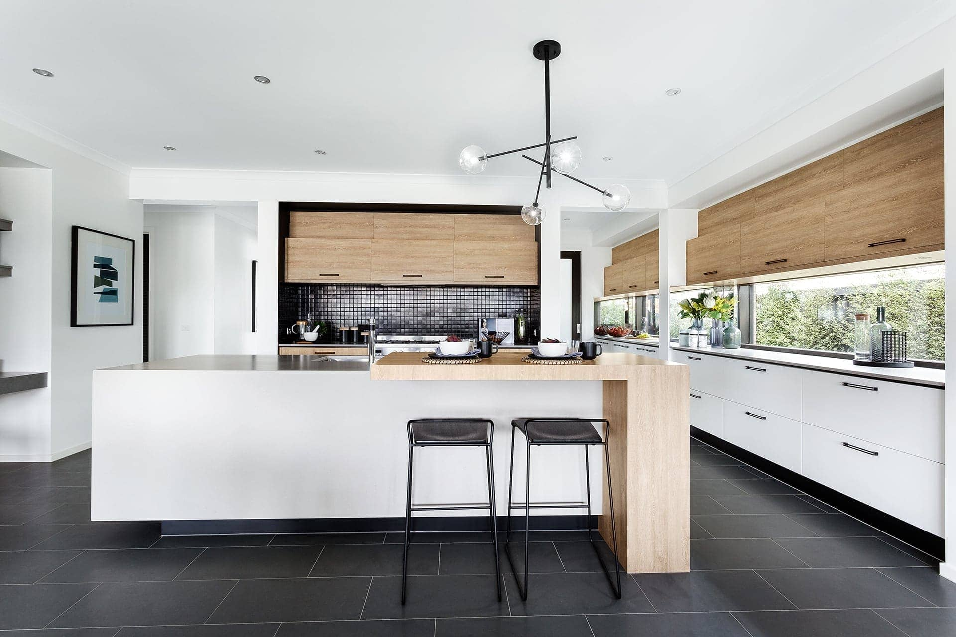 Modernist Black And White Kitchen With Shiny Black Splashback Tiles From  Metricon