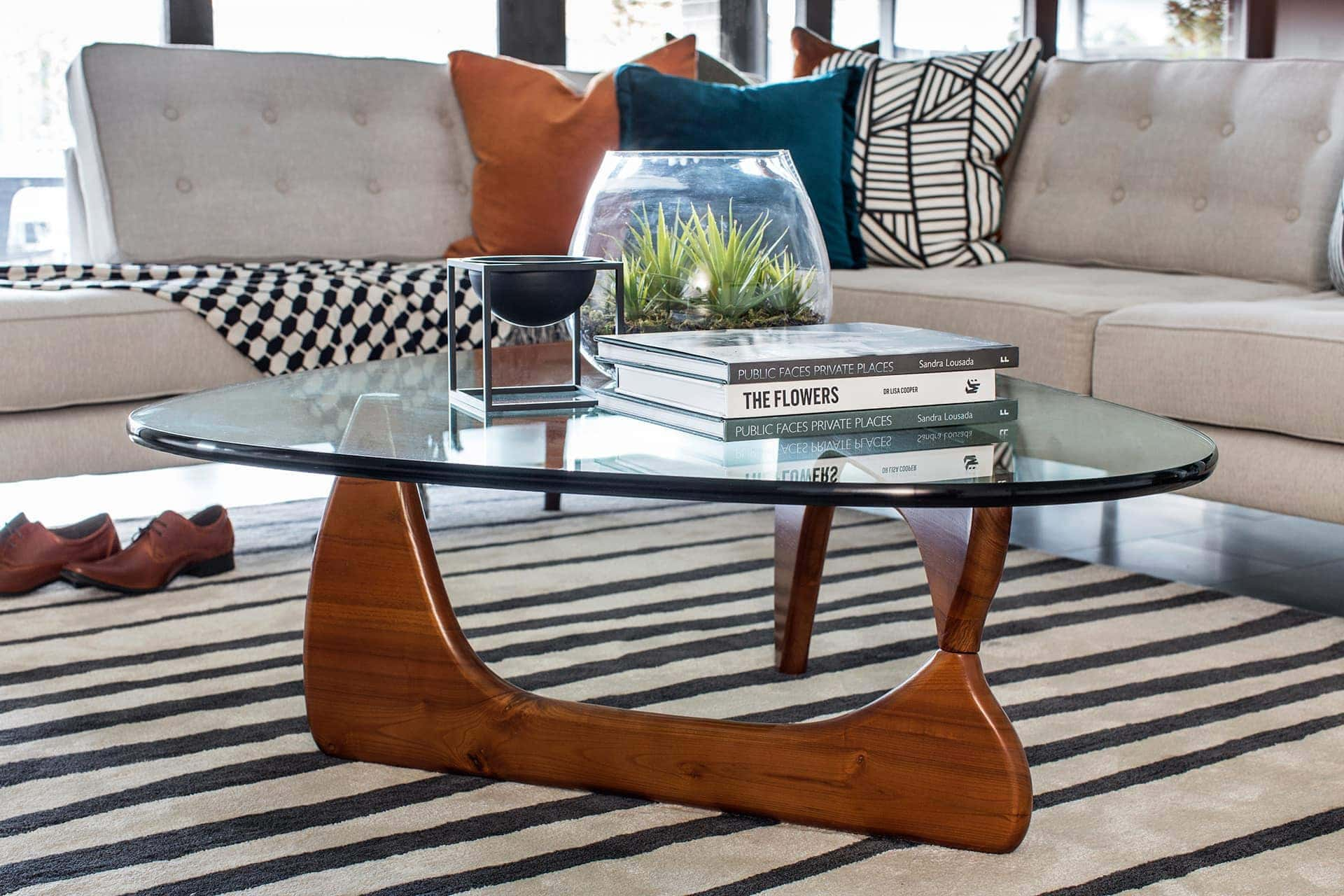 modernist living room design from metricon with mid century glass top coffee table