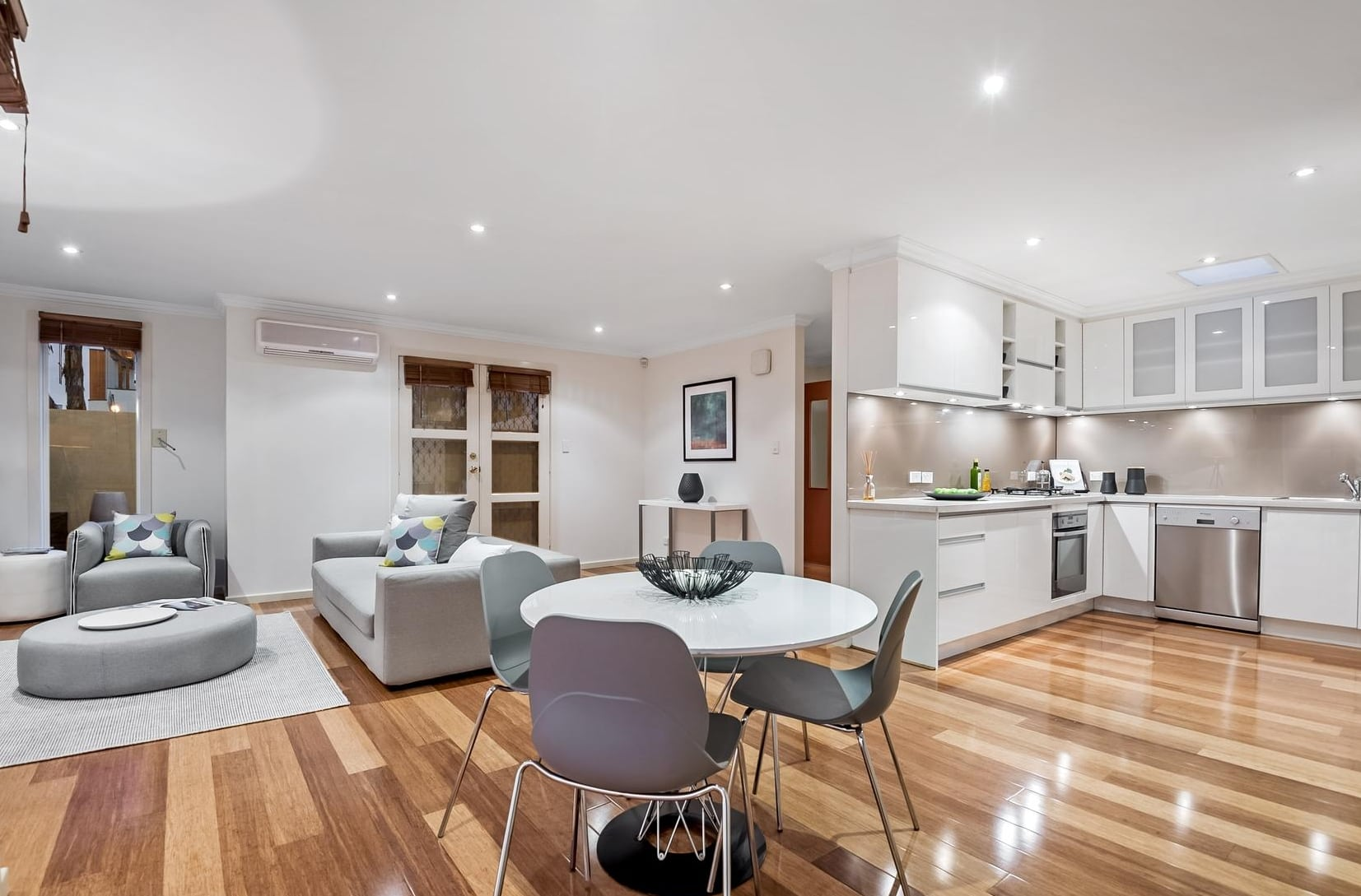 open plan living kitchen and dining room with polished floorboards