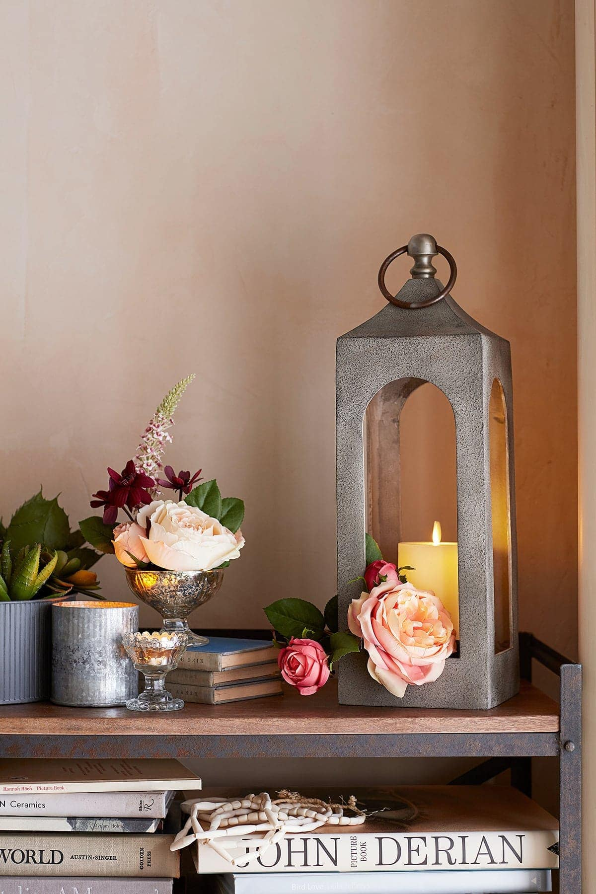 pottery barn artificial candle vignette with flowers in vintage glassware