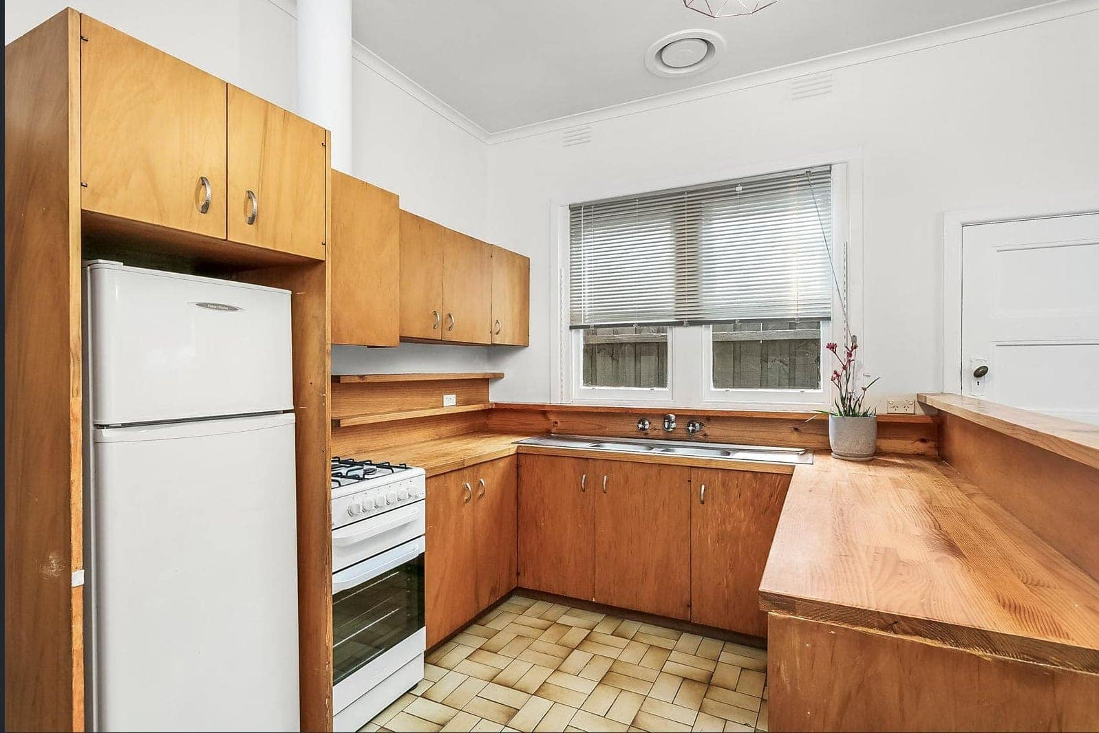 ugly looking 80s kitchen with brown cabinetry