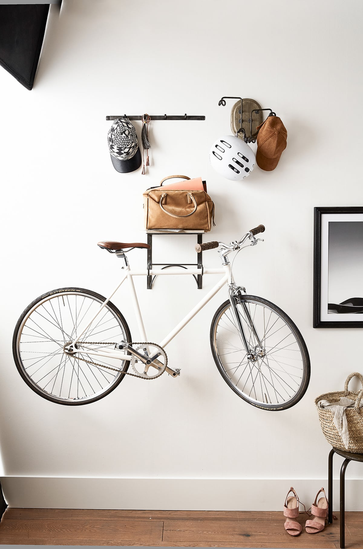 wall mounted bike rack inside front door with helmets and bag