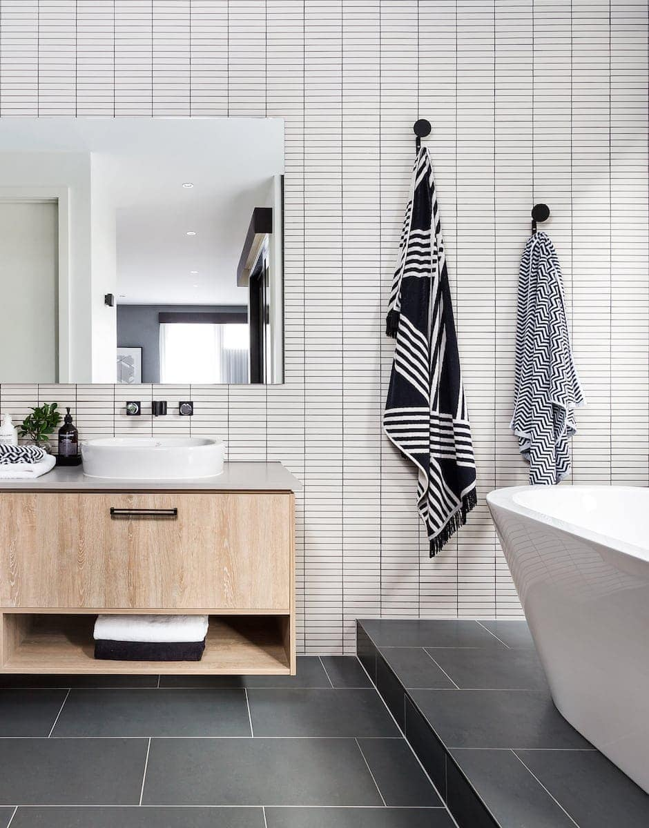 White Bathroom Tiles With Black Grout In Monochrome Bathroom From Metricon