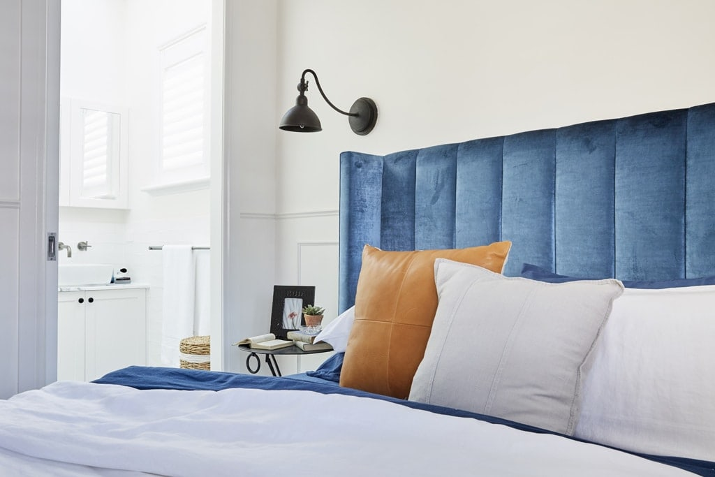 The block 2017 josh and elyse guest bedroom blue headboard