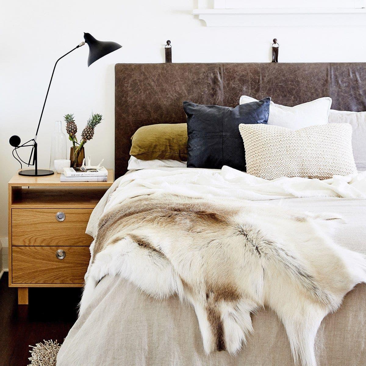 black arrow co bohemian master bedroom with leather headboard
