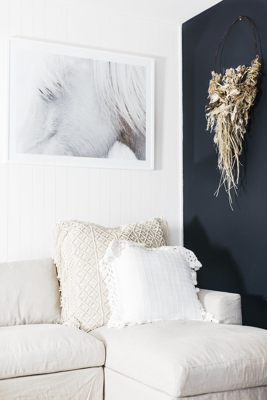 Hamptons furniture and homewares white linen sofa with horse artwork