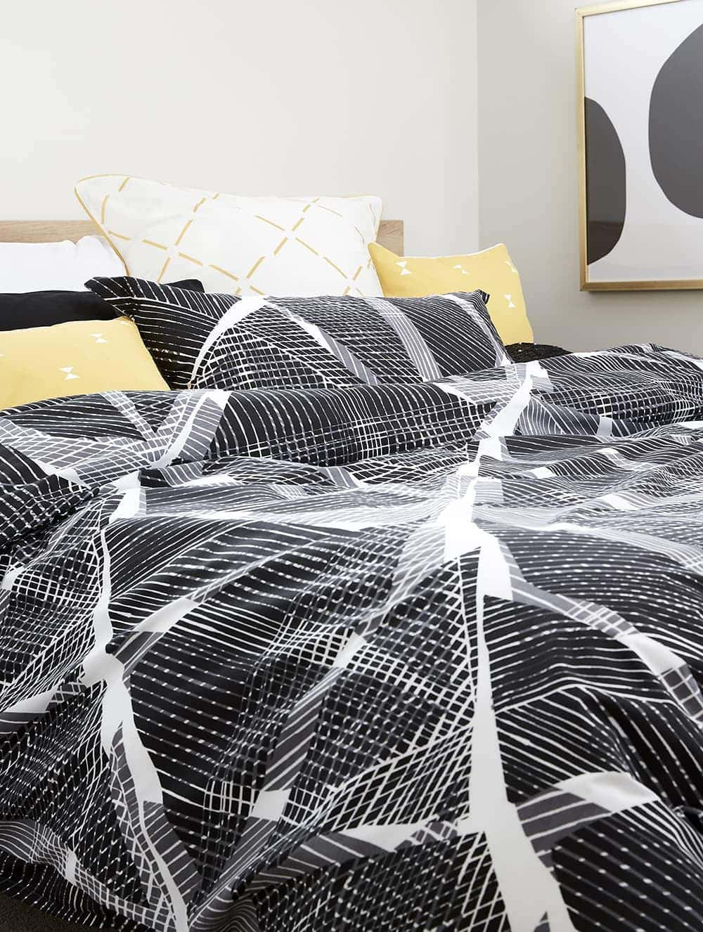 black and white bedding set from lorraine lea with yellow european cushions