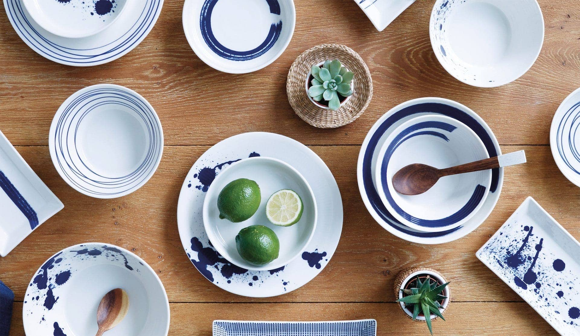 blue and white hamptons style dinnerware with limes in white bowl