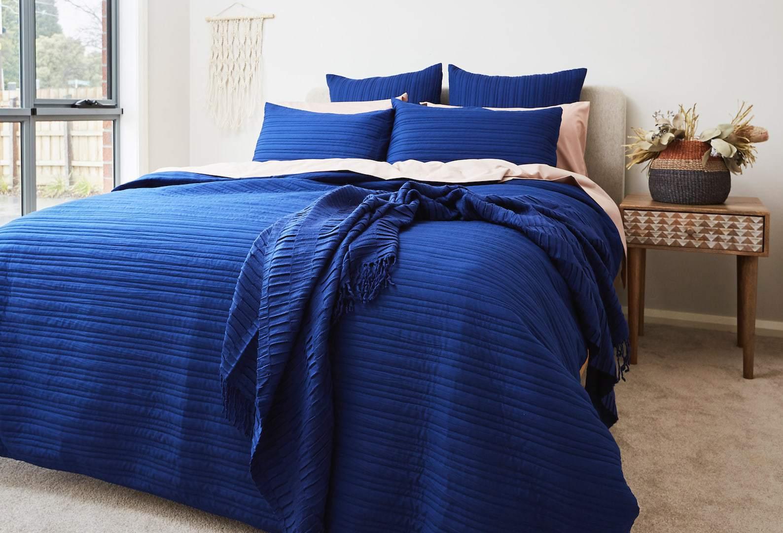 blue coastal bedroom ideas bright blue bedding set with macrame wall hanging lorraine lea