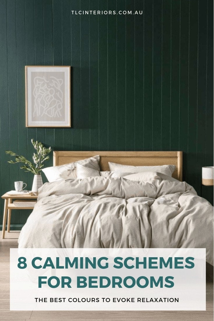 dark green bedroom wall with blonde timber bed