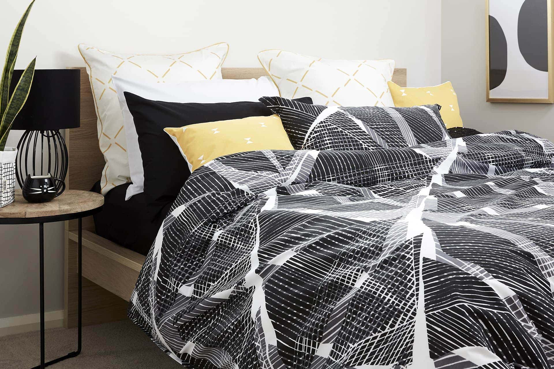 how to mix pattern at home in black and white bedroom with yellow euro cushions from lorraine lea