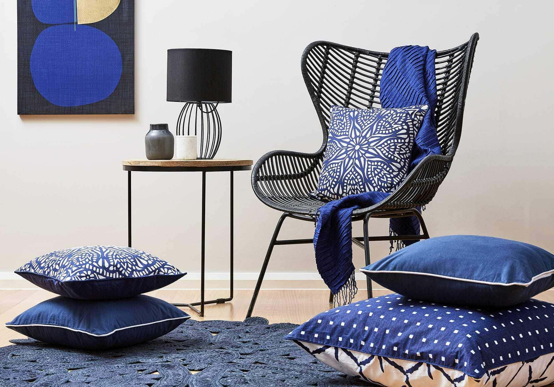how to mix pattern at home with blue and black decor in living room from lorraine lea