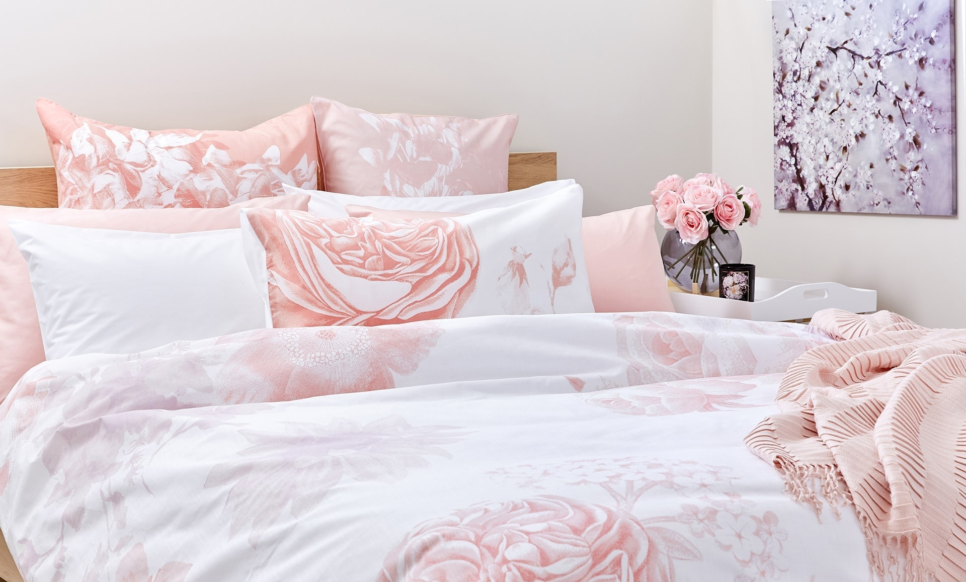 lorrain lea pink and white floral bedding set with floral artwork in bedroom