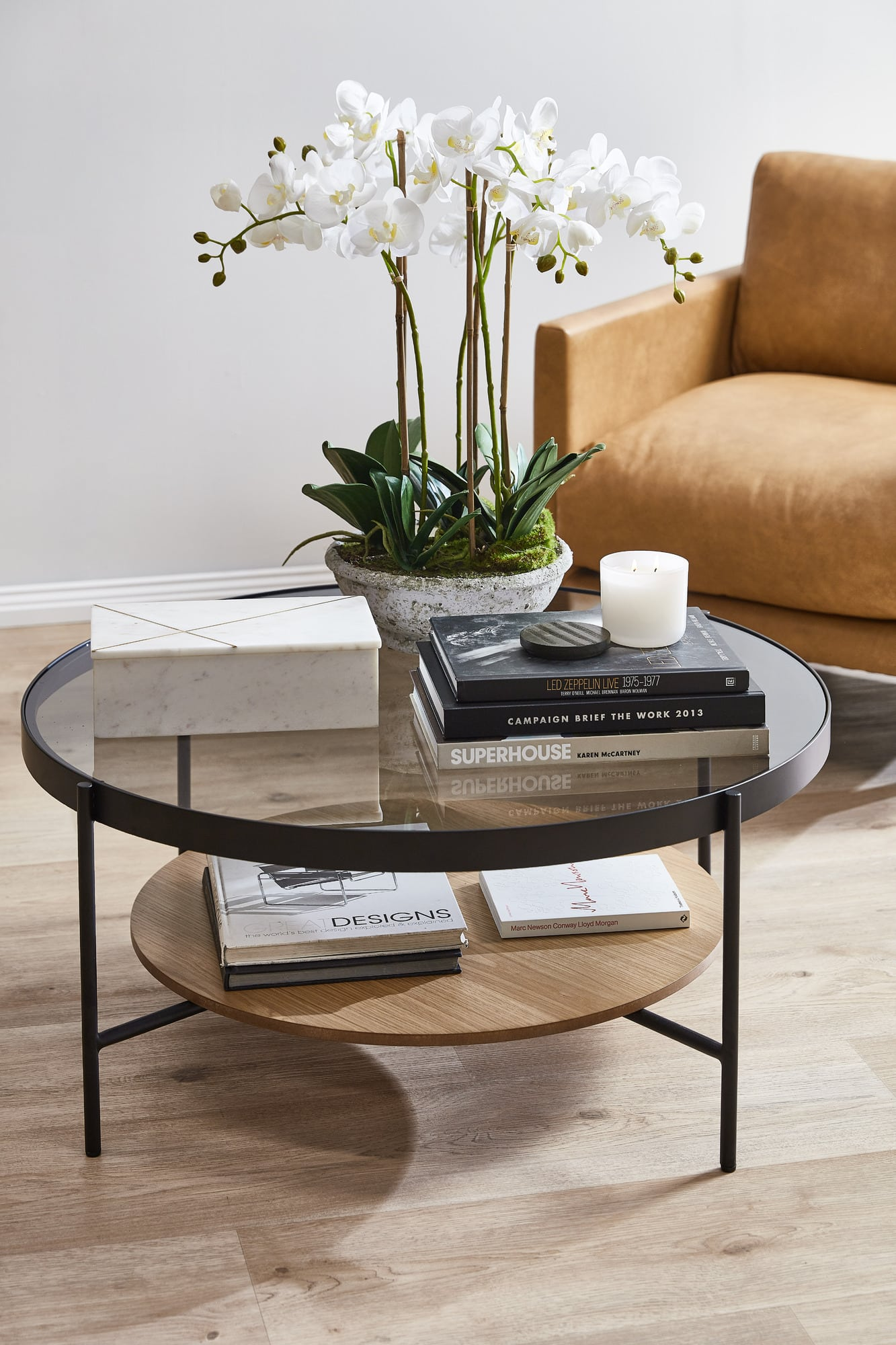temple and webster fake orchid on coffee table with leather sofa