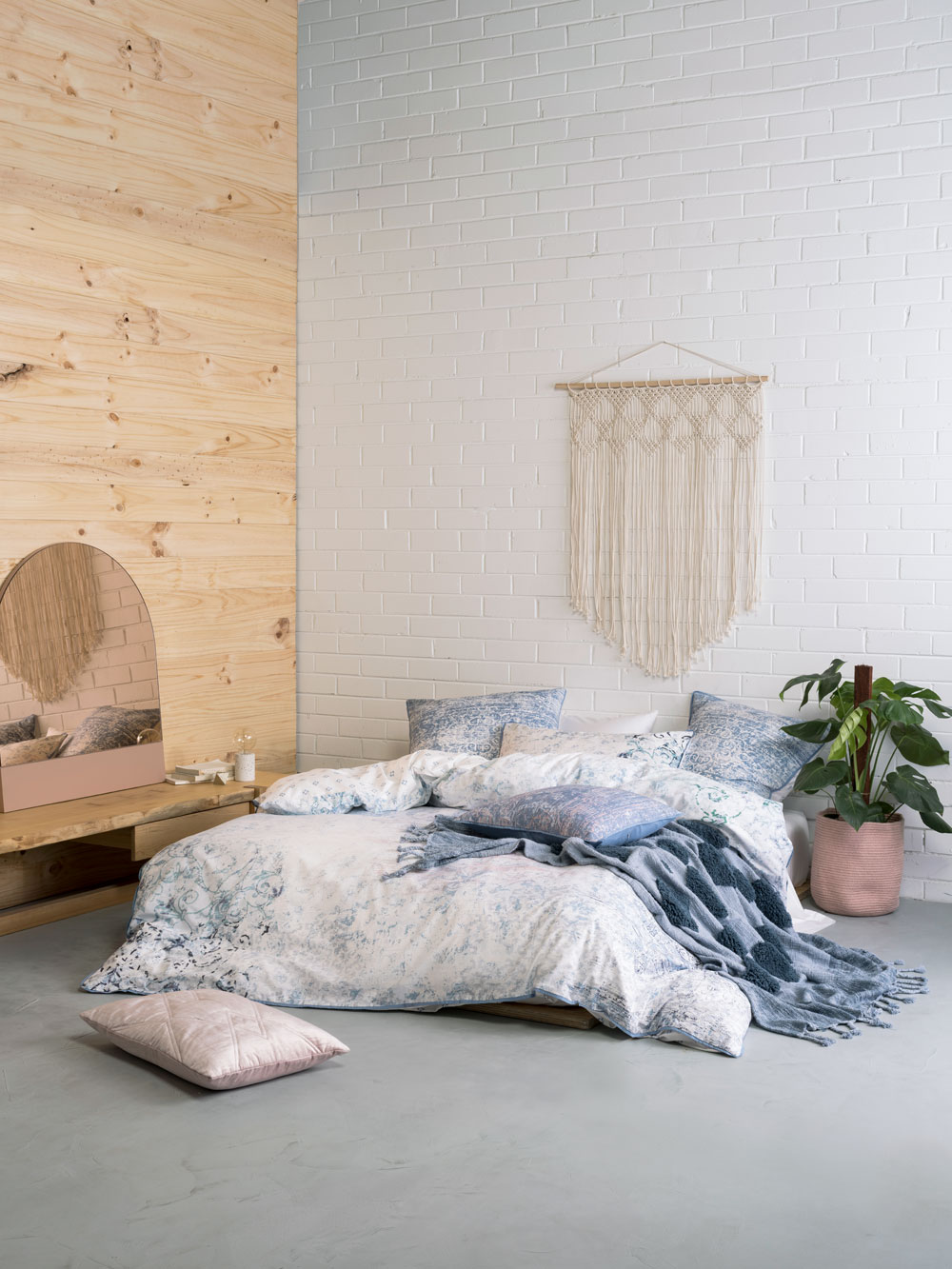 white bedroom with pine bedroom feature wall and bedding from linen house