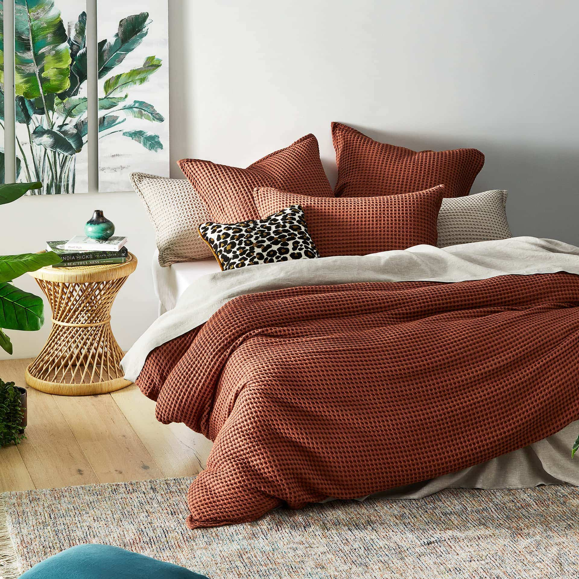 adairs terracotta lattice bedding set in white bedroom with leopard print cushion