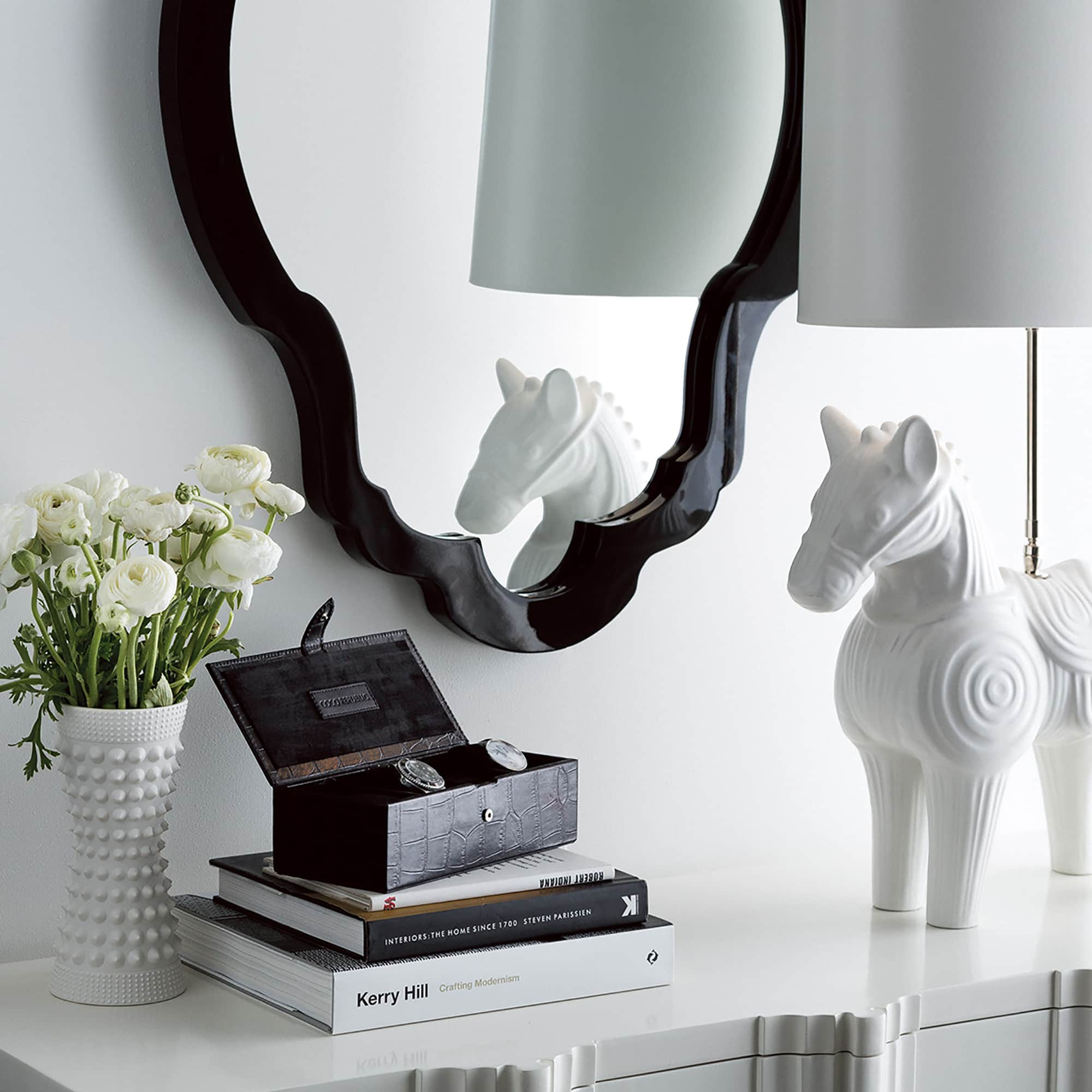 coco republic styling white ceramic horse on sideboard